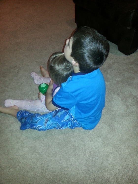 That big brother sure loves his little sister.