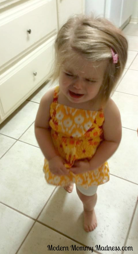 This is an actual photo of my child crying because she touched my hairy legs.